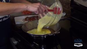 Kristi pours mixture into pan.