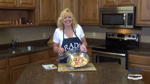 Kristi poses with completed bacon-feta frittata.
