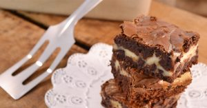 Chunky cheesecake brownies made with Rada products.