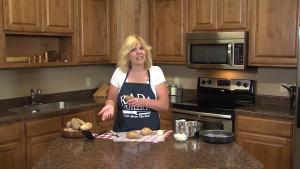 Kristi poses with fried potato ingredients.