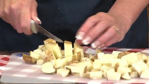 Kristi chops potatoes.