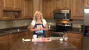 Kristi poses with Mug Shots Desserts cookbook.