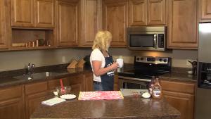 Kristi prepares to microwave brownie batter.