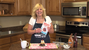 Kristi poses with completed brownie bliss and cookbook.