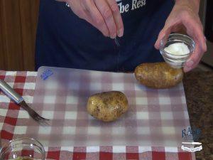 Kristi sprinkles potatoes with sea salt.