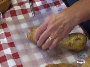 Kristi pokes holes in a potato with the Rada Granny Fork.