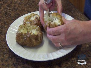 Kristi squeezes potatoes.