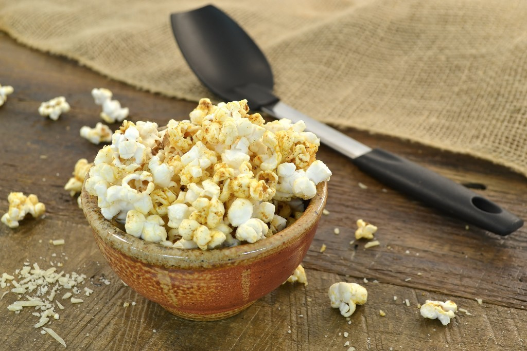 A delicious chili cheese popcorn bowl with a Rada Non-Scratch Spoon.