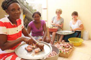 Climb for Haiti volunteers prepare a meal.