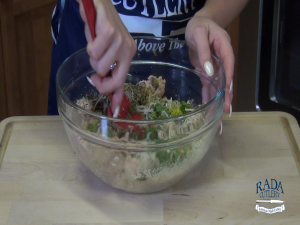 Jess stirs a bowl of ingredients with the Rada Mixing Spatula.