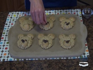 Kristi adds M&M's to oatmeal bear cookies.