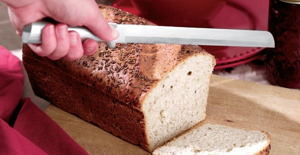 "Slicing a bread loaf with the Rada 10"" Bread Knife."