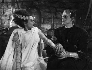 "Frankenstein's Bride (Elsa Lanchester) and the Frankenstein monster (Boris Karloff) in James Whale's ""Bride of Frankenstein""."