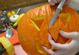 Kristi uses a Rada knife to carve a pumpkin.