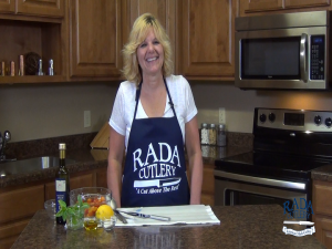 Kristi prepares to make a tomato basil salad with Rada Cutlery products.