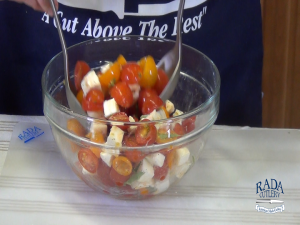 Kristi tosses a tomato salad with Rada Cook's Spoons.