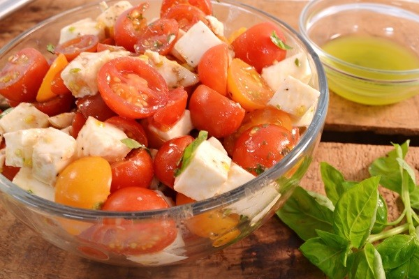 A delicious cherry tomato salad made with Rada Cutlery products.