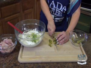 Jess chops dill pickles with the Rada Cook's Utility knife.