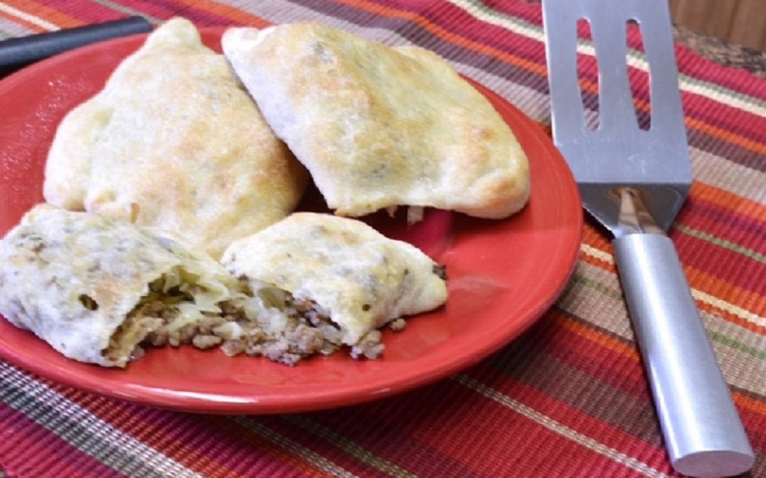 A plate of runzas with the Rada Cutlery Spatu.a