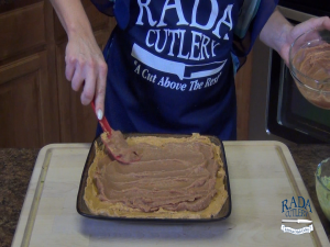 Jess spreads fat-free refried beans with a Rada Mixing Spatula.