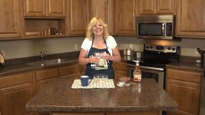 Kristi poses with meatloaf mug ingredients.