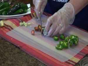 Kristi cuts peppers with the Rada Grapefruit Knife.
