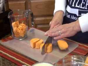 Kristi cuts sweet potatoes with a Rada knife.