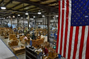 A picture of the Rada Cutlery factory with the American flag in the foreground.