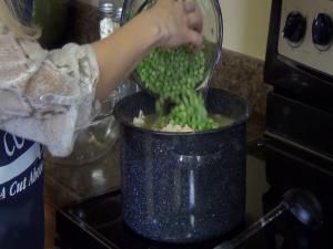 Jess adds frozen peas.