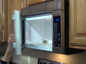 Kristi microwaves almond bark.