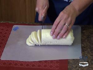 Kristi slices cookie dough.