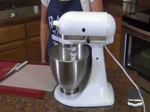 Kristi mixes ingredients.