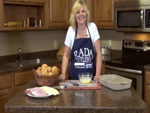 Kristi poses with Rada tools and ham sandwich ingredients.