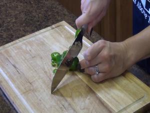 Jess chops a jalapeno with a Rada Cook's Utility Knife.