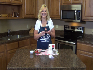 Kristi poses with an ice cream cupcake.