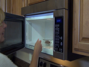 Kristi melts chocolate coating in the microwave.