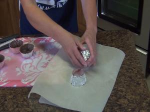 Kristi adjusts chocolate-coated cups.
