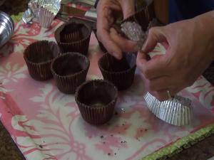 Kristi peels tin foil off chocolate cups.