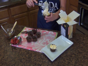 Kristi adds ice cream with the Rada Ice Cream Scoop.