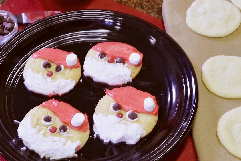Sugar cookies decorated as Santa Claus.