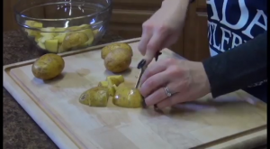 Jess slices potatoes with the Rada Super Parer.