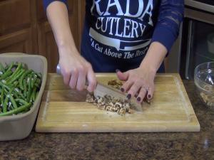 Jess chops walnuts with the Rada Cook's Knife.