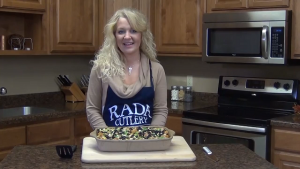 Jess poses with her completed Mexican Tater Tot Casserole, made entirely with Rada Cutlery products.