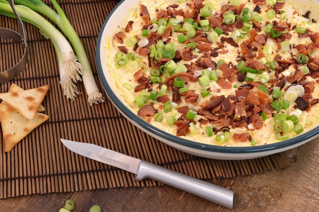 A delicious bacon cheddar dip with a Rada Regular Paring knife.