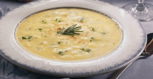 A delicious bowl of Cheddar Broccoli Soup made with a Rada Quick Mix.