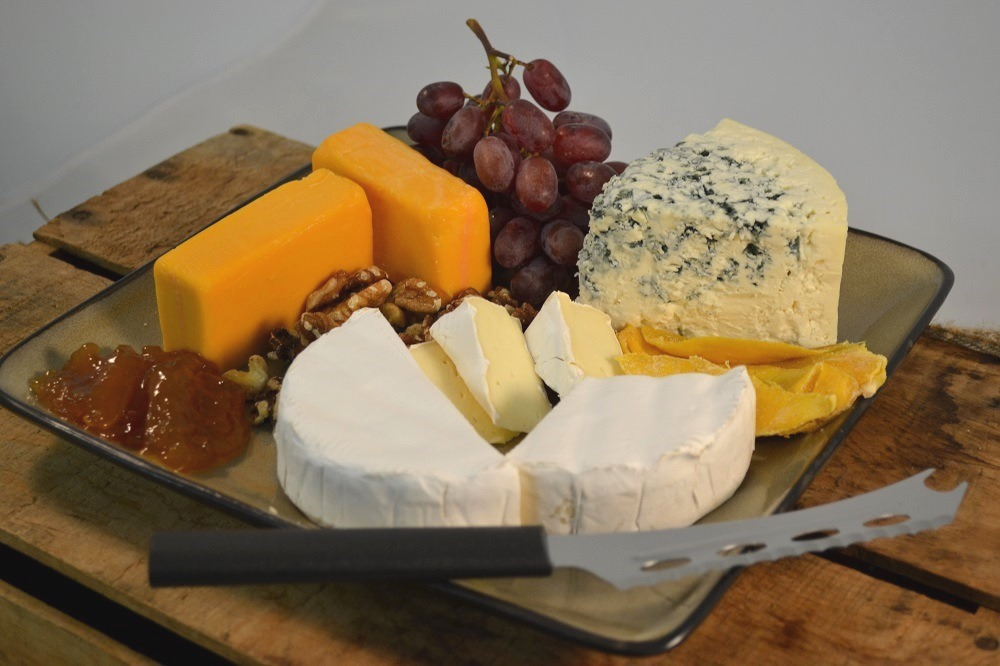A beautiful cheese platter and a Rada Cheese Knife.