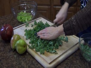 Jess uses the Rada French Chef knife to chop kale.