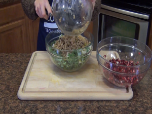 Jess adds rice to her pomegranate salad.
