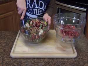 Jess mixes her salad.