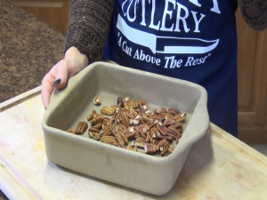 Jess prepares to toast pecans in the Rada Square Baker.